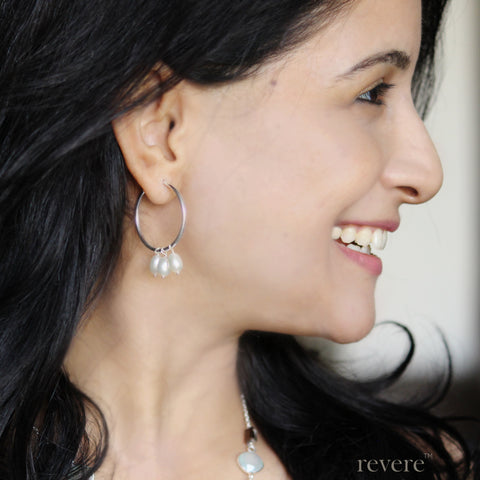 These dainty silver hoop earrings are embellished with freshwater white pearls. Wear them to work or party!