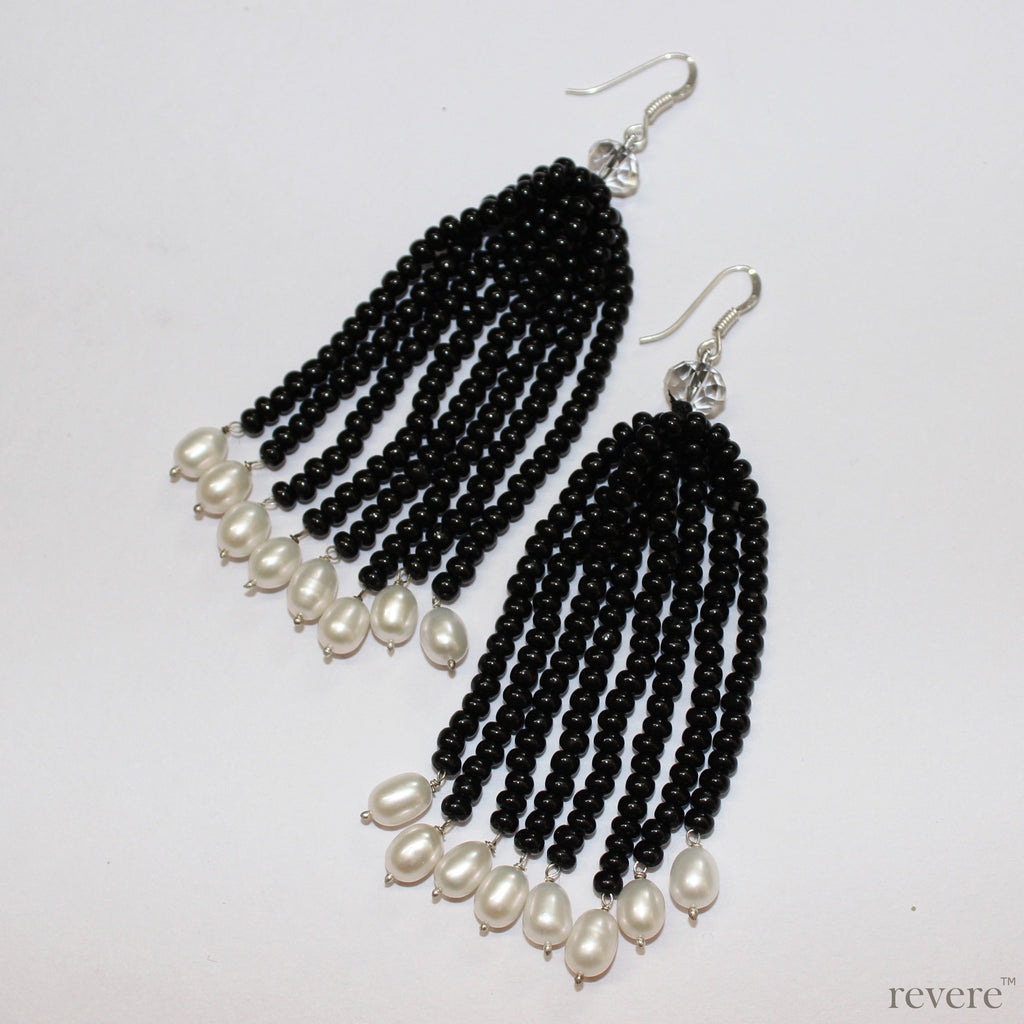 The cool.. showcased in the Black Velvet earrings in sexy black beads ending in white freshwater. Pairs superbly with the Black Velvet necklace.
