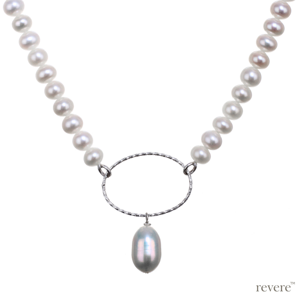 Ecru is a chic strand of freshwater white pearls strung together with a sterling silver oval ring and pearl drop for that extra bit of pop.