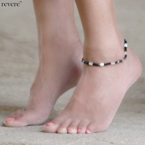 vDangles delicately off your ankle with freshwater pearl, moonstones, crystal and pyrite on 925 sterling silver.