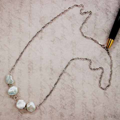 "Elegant white keshi cultured freshwater pearls set in 925 sterling silver. ""Drops of Jupiter"" is the necklace of choice to lift you up anytime... at work or play!"