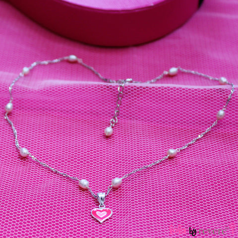 Sterling silver pink heart shaped pendant on a sterling silver chain scattered with baby pink pearls. Ideal for any little girl who loves pink.