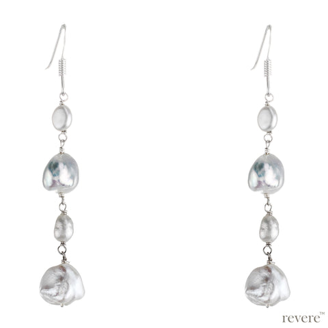 "High quality white keshi pearls and seed pearls dropped on a sterling silver earrings. Long dangling earrings ""Revel"" will dance on your neck."