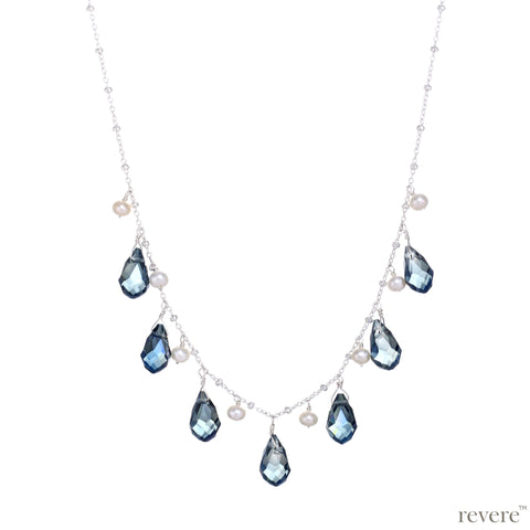 "Effervescent blue crystal weaved together with freshwater white pearls as a beautiful statement necklace. ""Verve"" is sure to be the fun accessory in any gathering!"