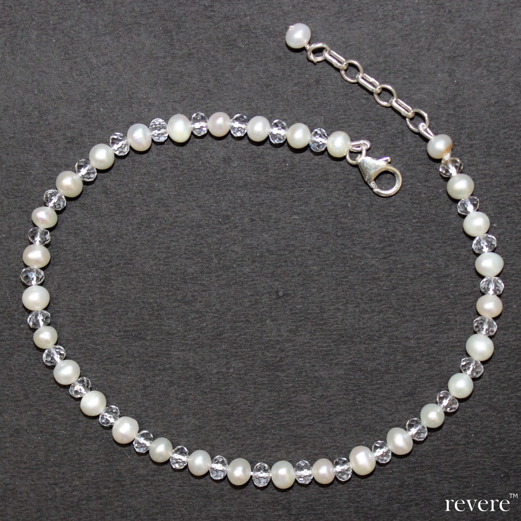 The Aglow anklet is a blazing combination of white freshwater pearl and multi-faceted glass crystal on sterling silver. A striking accessory to your footwear.