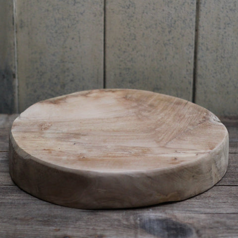 Chunky round chopping board made from teak.