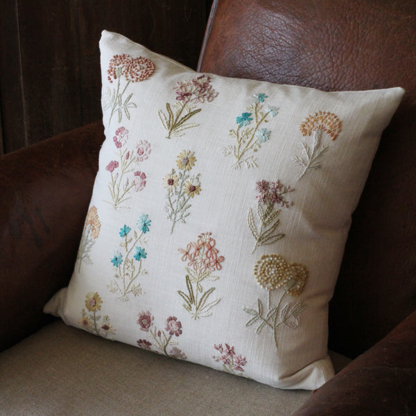 Embroidered flower cushion