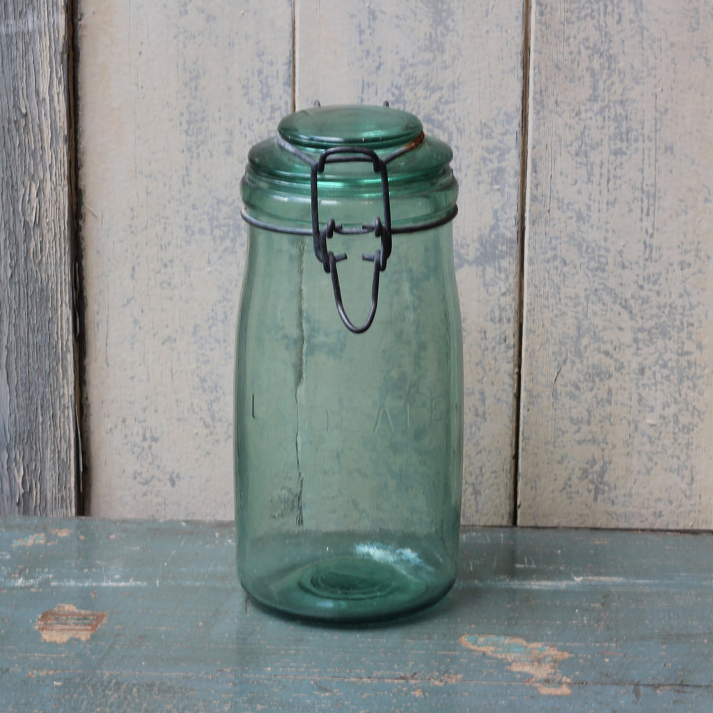 Vintage green glass storage jar - closetandbotts