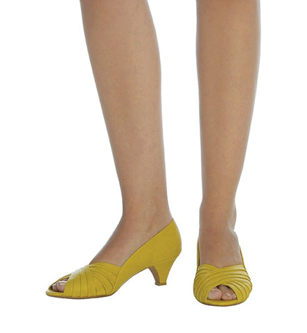 Gabriela Heel in Yellow by Roni Kantor