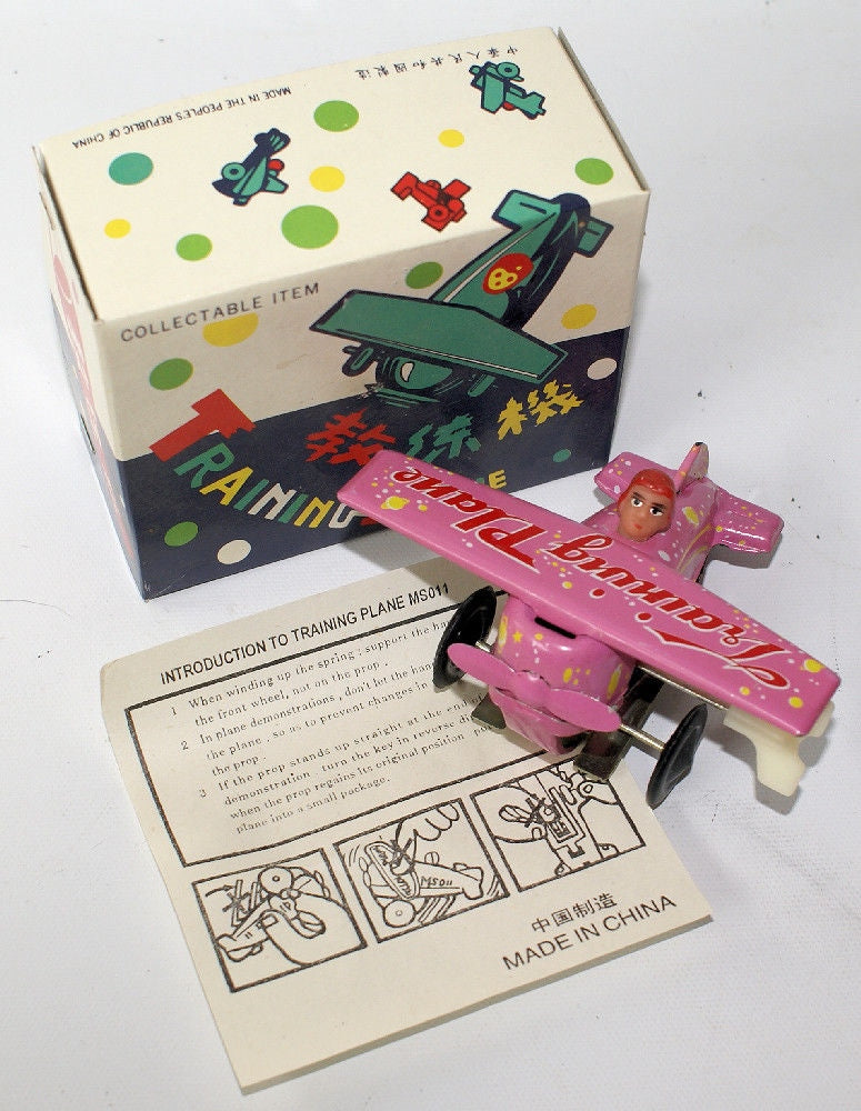 Vintage Tin Lithographed Pink Wind-up Training Plane Airplane MS011 in Box - Continental Hobby House