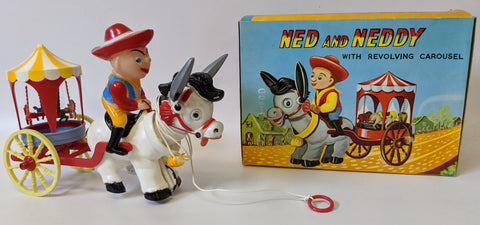 Vintage 1960's (OK, Hong Kong) NED AND NEDDY Pull Toy w/ Revolving Carousel
