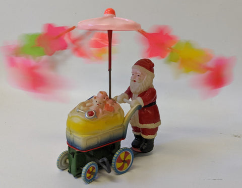 RARE Vintage (Occupied Japan) Wind-up Celluloid Santa w/ Toy Cart Whirly Gig Toy