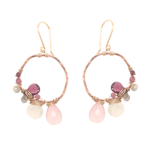 Gold and rose gold hoop earrings with asymmetrical gemstone wraps including rose quartz, moonstone, and rhodolite garnet