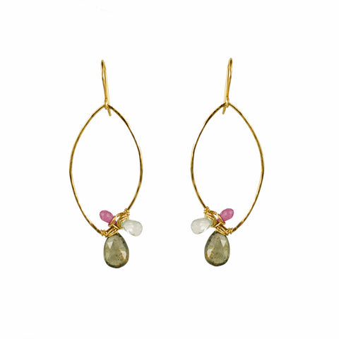 Gold oval hoop earring with wrapped gemstones including moss aquamarine and pink sapphire