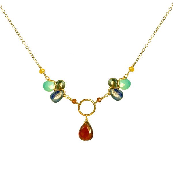 Gold pendant necklace with hessonite gemstone drop and gemstone pendants on the side of the hoop including pyrite and turquoise