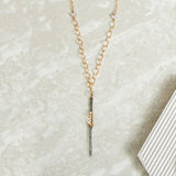 Sterling silver gunmetal finish vertical bar pendant with gold wraps and herkimer diamonds