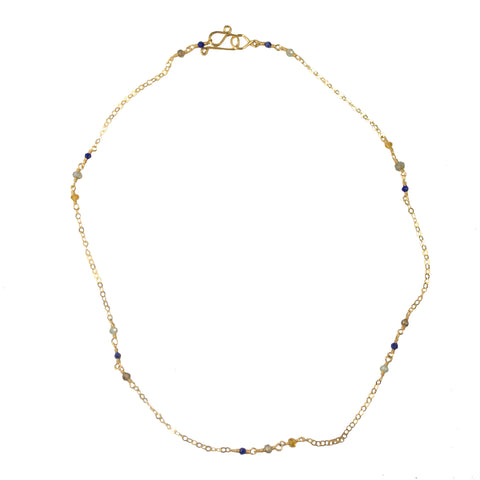 Small gemstones on gold chain choker necklace