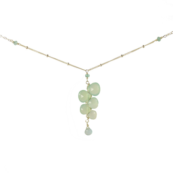 Pendant necklace from chalcedony gemstones woven together with sterling silver wire and seafoam chalcedony drop