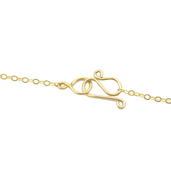 "Gold classic vannucci ltd tension ""S"" clasp handcrafted for each piece"