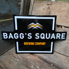 Custom embossed aluminum tacker for Bagg's Square Brewing Co