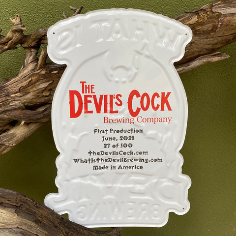 The back side of the What is the Devil Brewing tacker from Devil's Cock Brewing Co