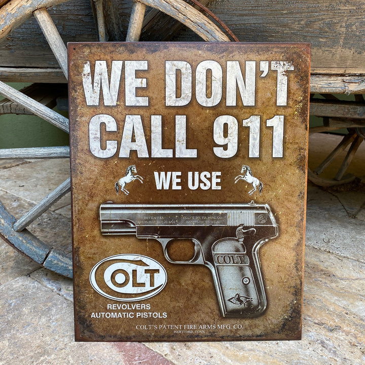 "Vintage Look ""We Don't Call 911 We Use Colt Revolvers"" Metal Sign Tin Tacker"