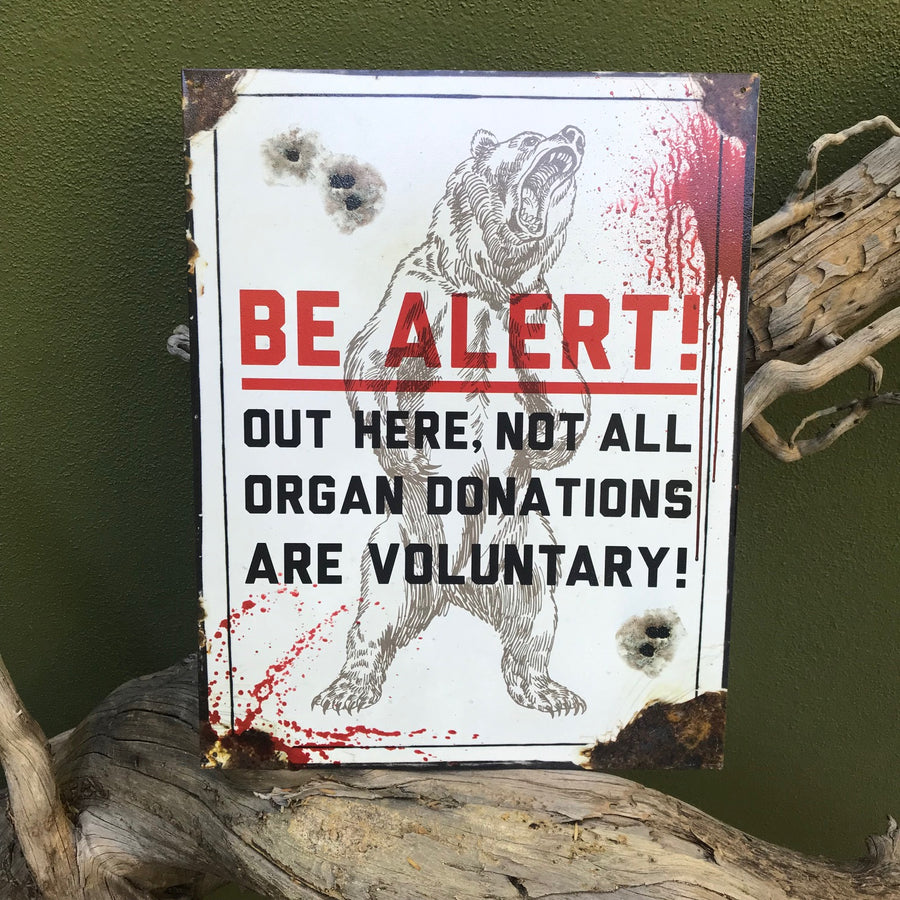 "Vintage Look ""Be Alert! Out Here, Not All Organ Donations are Voluntary"" Metal Sign"