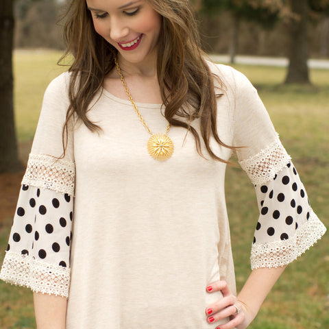 cs gems oat top with black polka dot bell sleeves