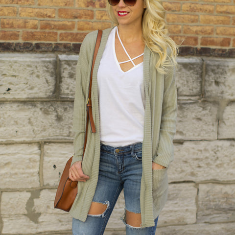 79e80dbd8 Warmer weather is around the corner and one of our favorite things to wear  for spring are light weight cardigans. The current criss cross tee trend  adds the ...
