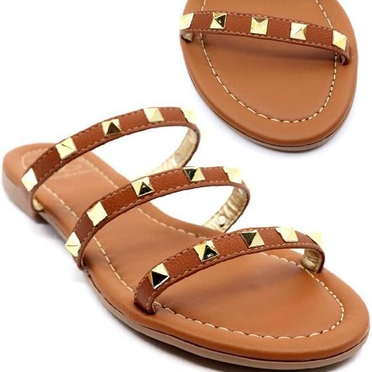 Tan strappy sandal with metal pyramid studs