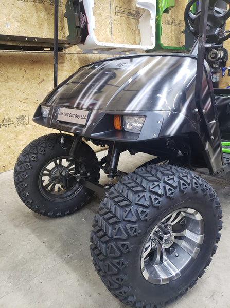 Gotham or Vampire wheel and off road tire combo in gunmetal finish installed on golf cart.