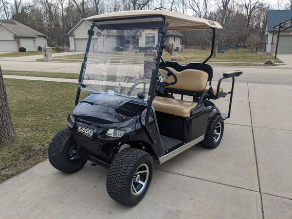 Stainless steel rocker panels installed on customer's EZGO TXT Valor model.