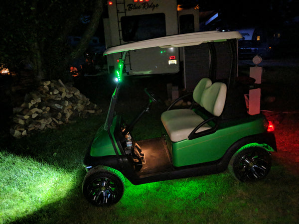 Deluxe street legal LED light kit installed on a Club Car Precedent shining at night.