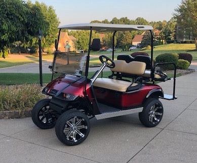 Customer photo of Tempest machined black wheels and low profile tires installed on EZGO TXT golf cart.