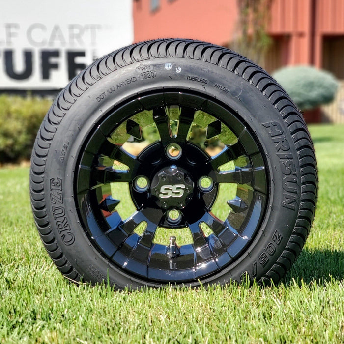 Vampire gloss black 10 inch rim with low profile turf tire.