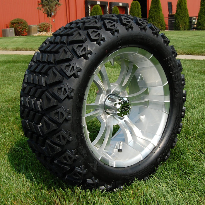 "Angled view of 14"" Vampire silver and machined off-road golf cart wheel and tire combo set with 23"" Arisun tires."