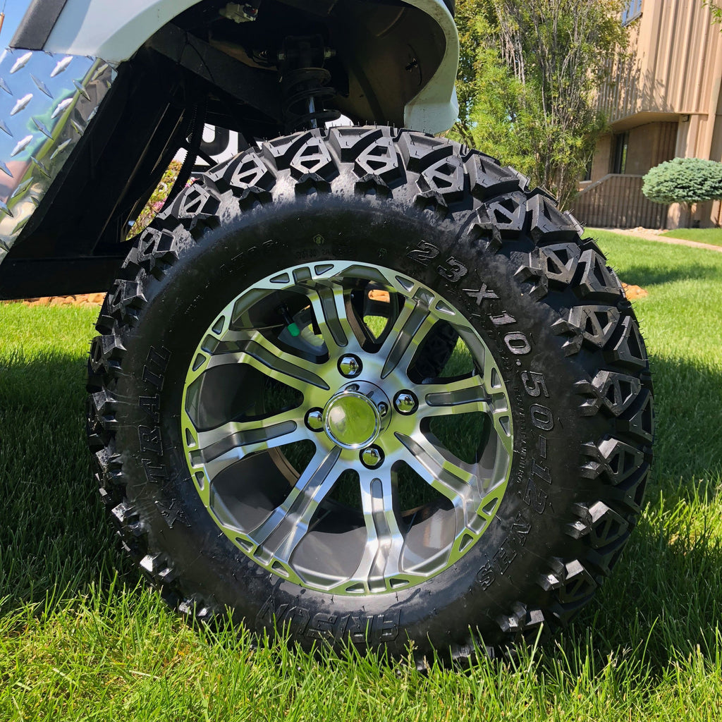 "Gunmental finish 23"" off-road wheel and tire combo installed on lifted Yamaha Drive."
