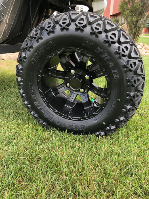 "Matte black finish on off road wheel and tire 23"" combo installed on Yamaha Drive golf cart."