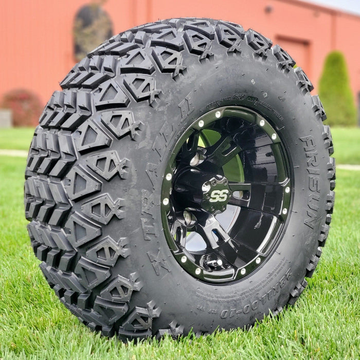 "Angled view of 10"" gloss black Stallion off-road golf cart wheel and tire combo set with 22"" off road tires."