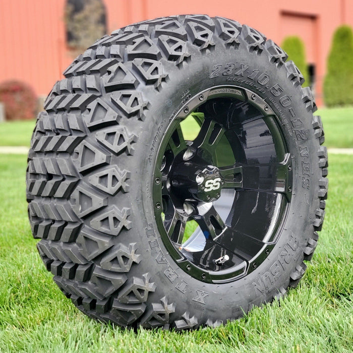"Angled view of 12"" gloss black Stallion off-road golf cart wheel and tire combo set with 23"" off road tires."