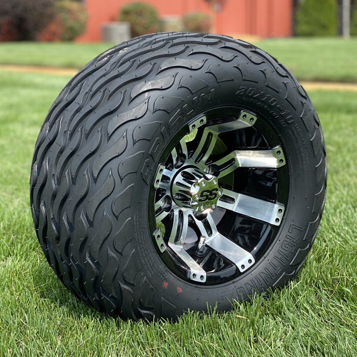 "Angled view of 10"" black and machined aluminum Storm all-terrain golf cart wheel and tire combo set with 20"" Arisun tires."