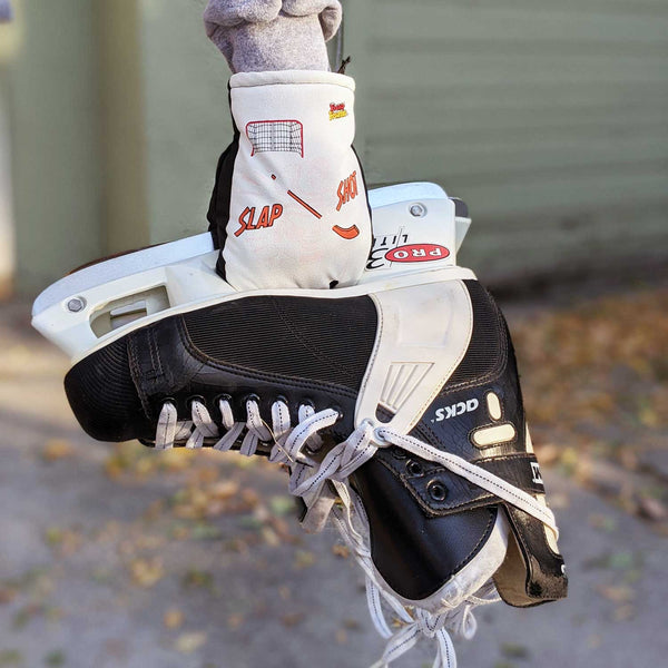 Freezy Freakies Slap Shot Hockey gloves holding the all-time greatest skates ever