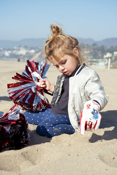 Cheerleader Freezy Freakies gloves are perfect for the beach
