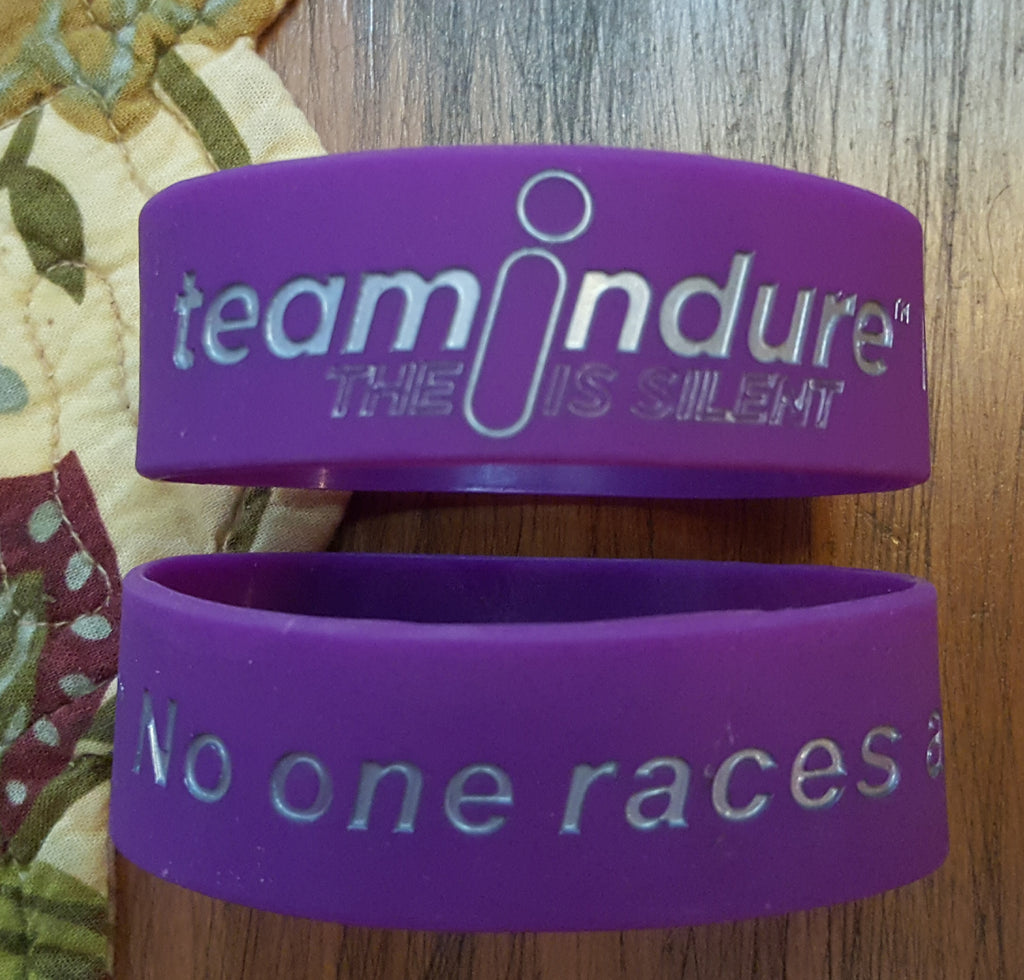 "teamindure ""No One Races Alone"" wristband"