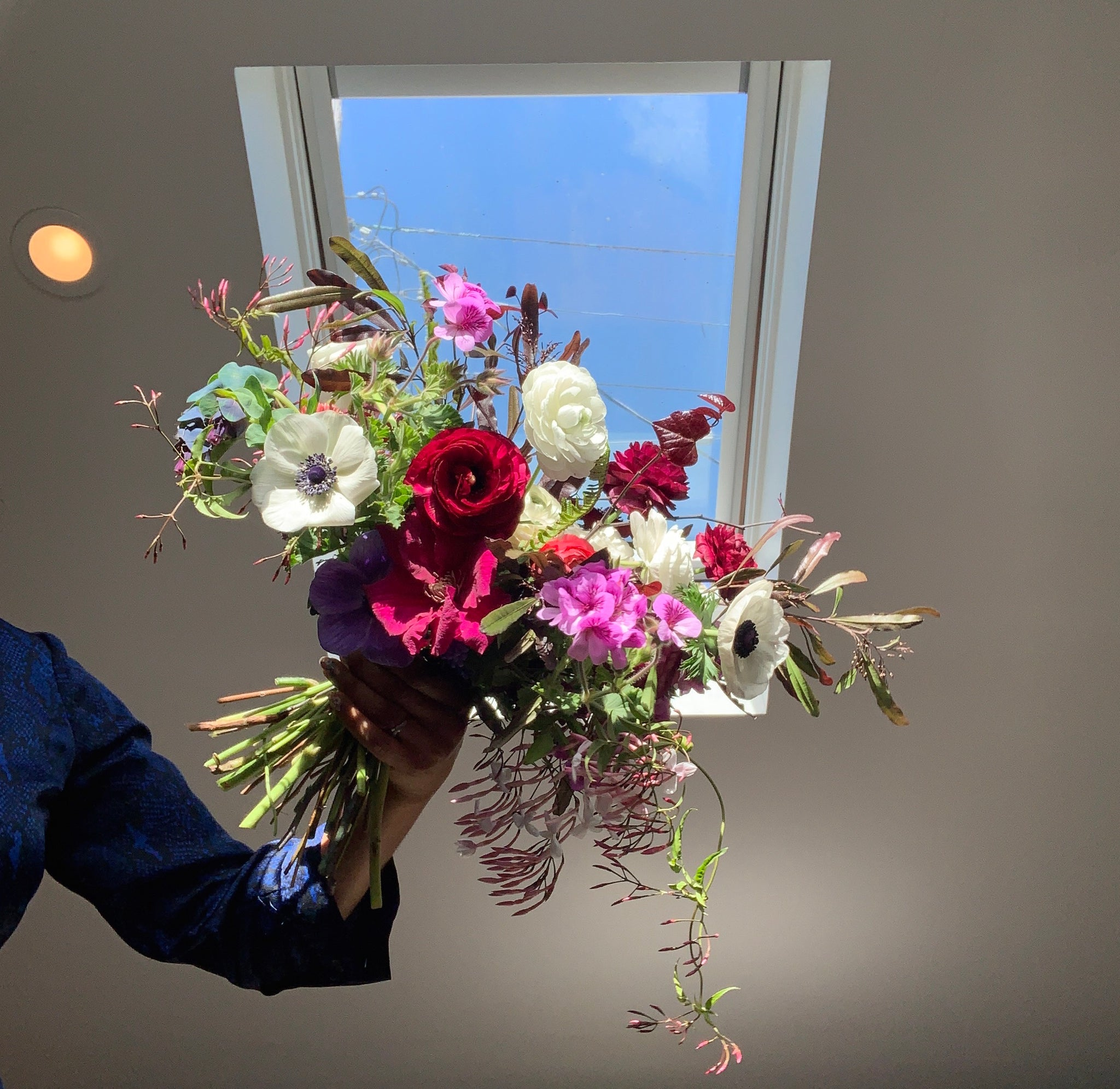 Hand tied bouquet made at home during COVID-19 using the spiral method,