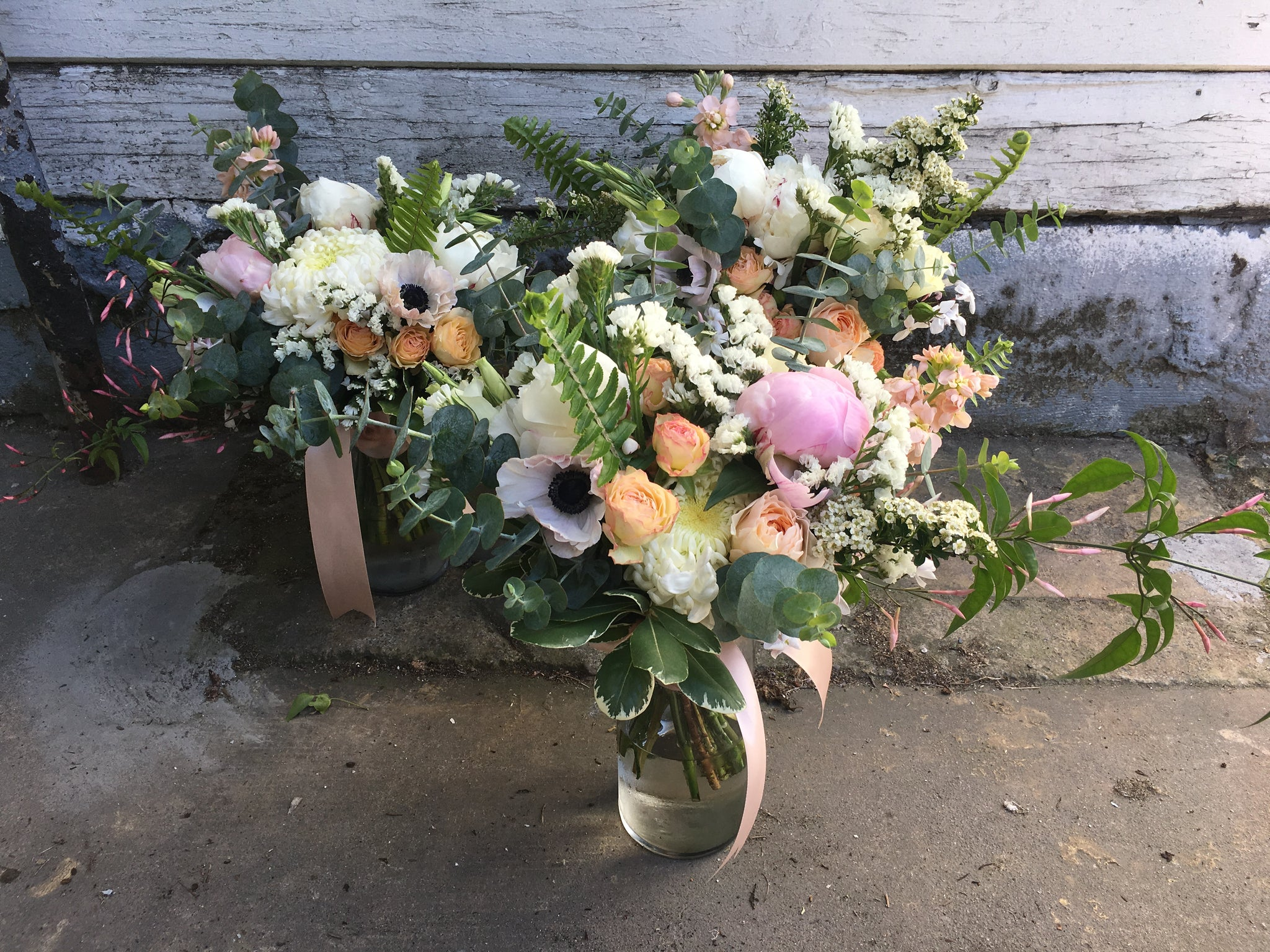 Bridesmaid bouquets in blush and whites by Gorgeous and Green for a local wedding.