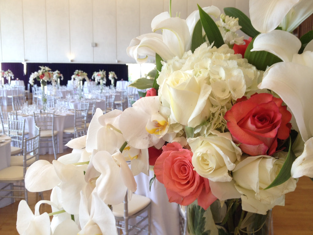 Cal wedding flowers, tall trumpet vases by Gorgeous and Green