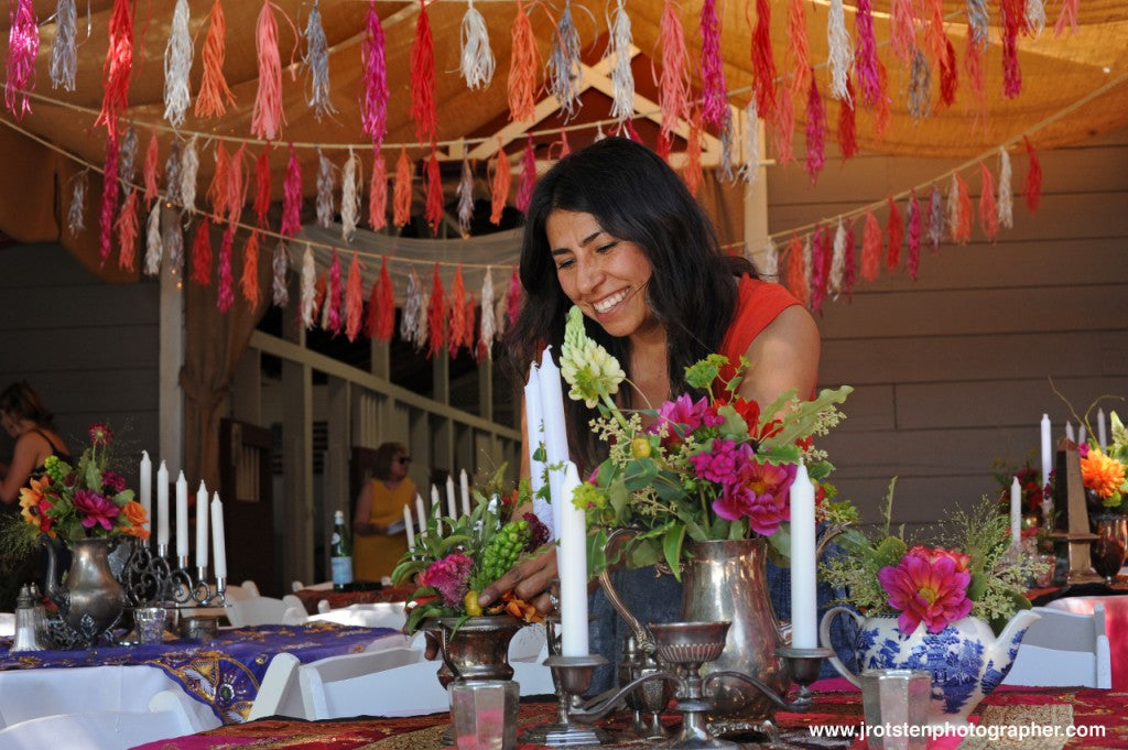Pilar Zuniga of Gorgeous and Green designing tables at Diablo Ranch for a wedding
