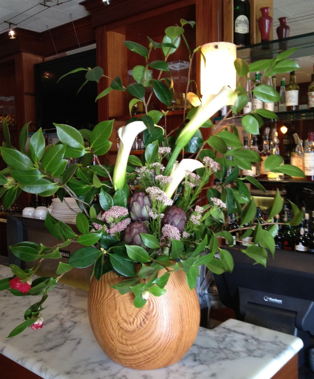 Calla and artichoke restaurant arrangement by Gorgeous and Green