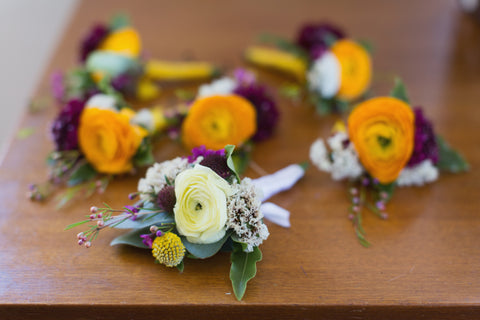 ranunculus boutonnieres in golds and plums by Gorgeous and Green, Tiburon Wedding